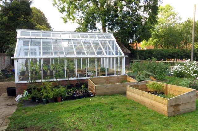 A greenhouse in a garden.