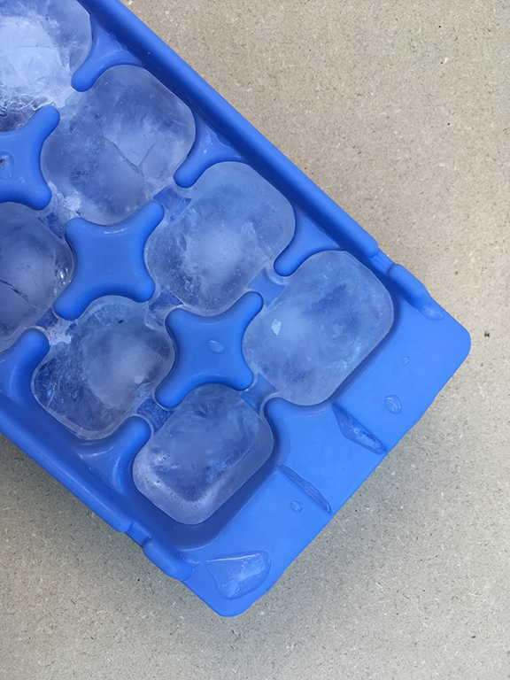 Illustration of freezing liquid water to make ice cubes