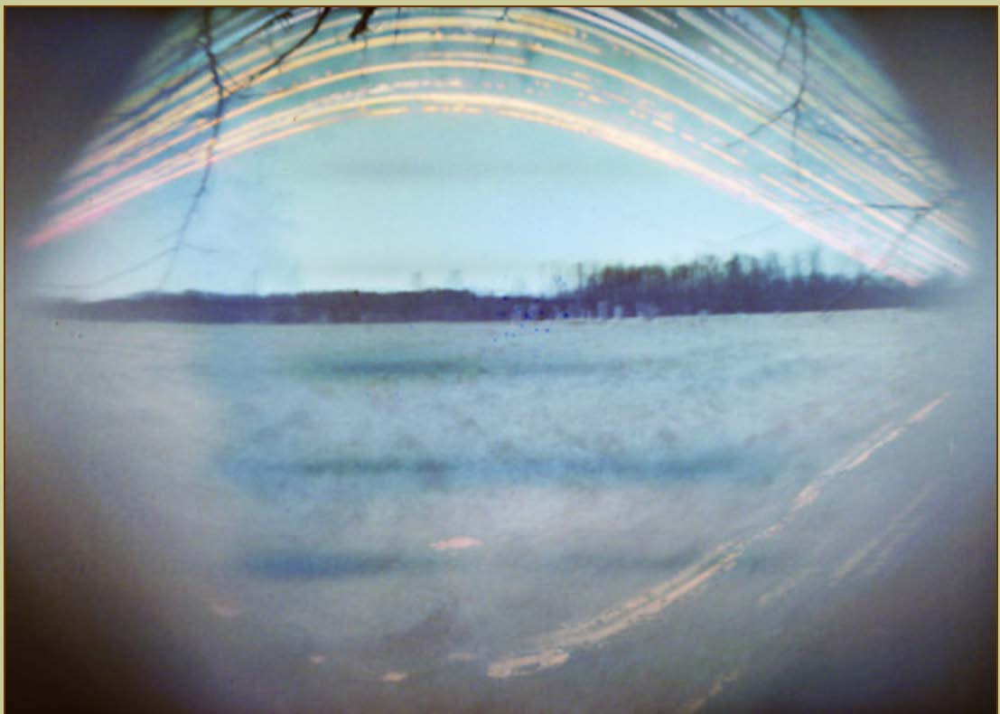 Six month exposure to the apparent daily path of the Sun across the sky from the winter to summer solstices via a pinhole camera at Keppel Henge, Ontario Canada.