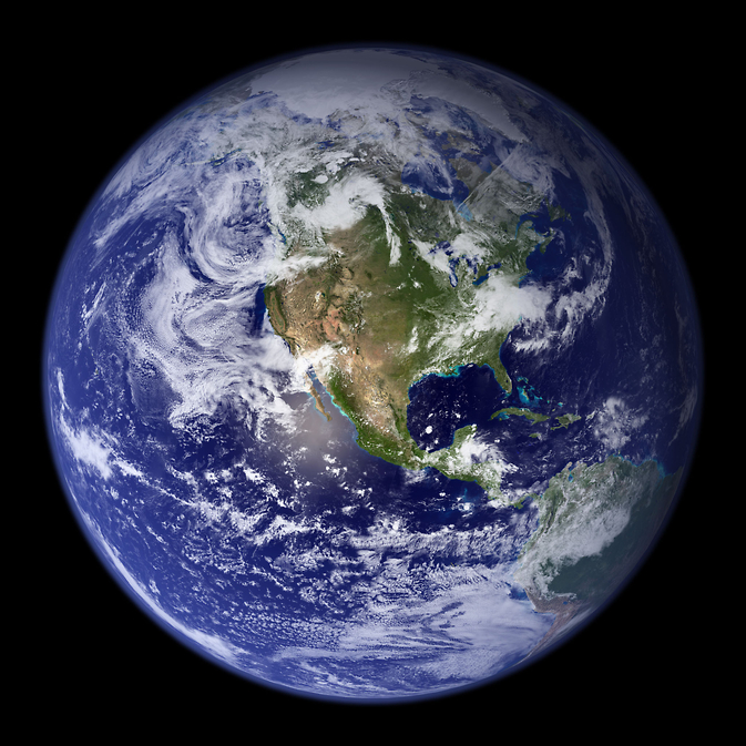 The blue marble. A composite image of Earth from space. It shows all four components of Earth's climate system. The atmosphere with its complex cloud patterns. The ocean, which covers about 70% of Earth's surface. The cryosphere is visible as the white areas on the top: sea ice covering the Arctic Ocean and the Greenland ice sheet. Green colors on land and turquoise shades along the ocean's margin indicate the biosphere as forests and phytoplankton blooms. Notice in the lower left the thin layer of the atmosphere surrounding Earth.