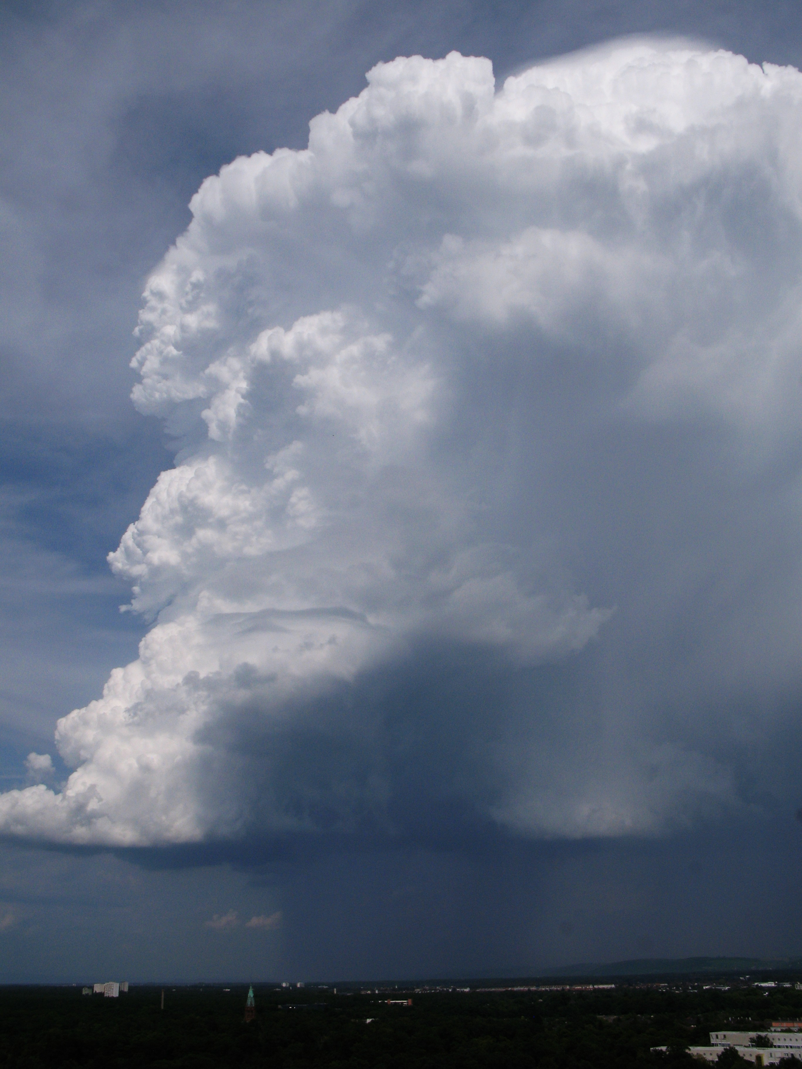 Picture of a convective cloud. Warming from latent heat release during condensation makes the interior of a cloud more buoyant than the surrounding air and thus intensifies convection. From globalwaterforum.org.