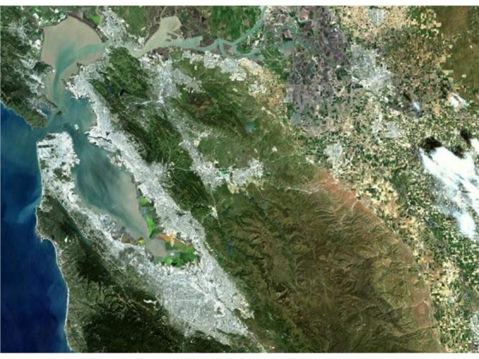 Figure 9.4. San Francisco Bay area, California. This Band 3,2,1 image shows the spring runoff from the Sierras and other neighboring mountains into the Bay and out into the Pacific (Image from Landsat 7 Project, NASA).