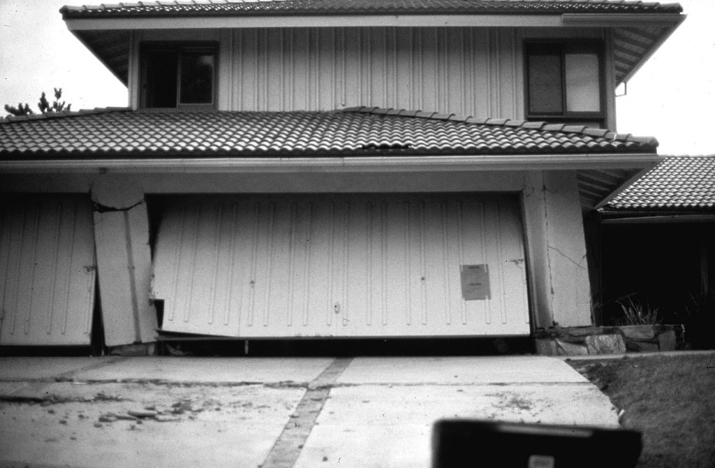 Soft-story failure to three-car garage during 1971 Sylmar, California, Earthquake