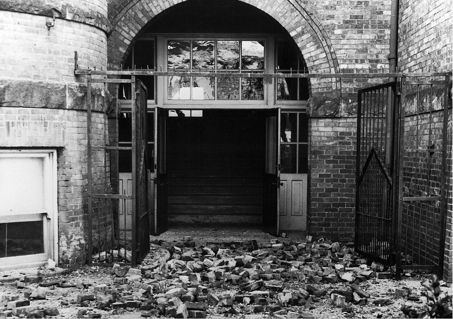 Close-up of an entrance to Lafayette School in West Seattle, covered with bricks that fell from this unreinforced masonry building during the 1949 Puget Sound Earthquake. Fortunately, the school was not occupied at the time, and no children were killed or injured