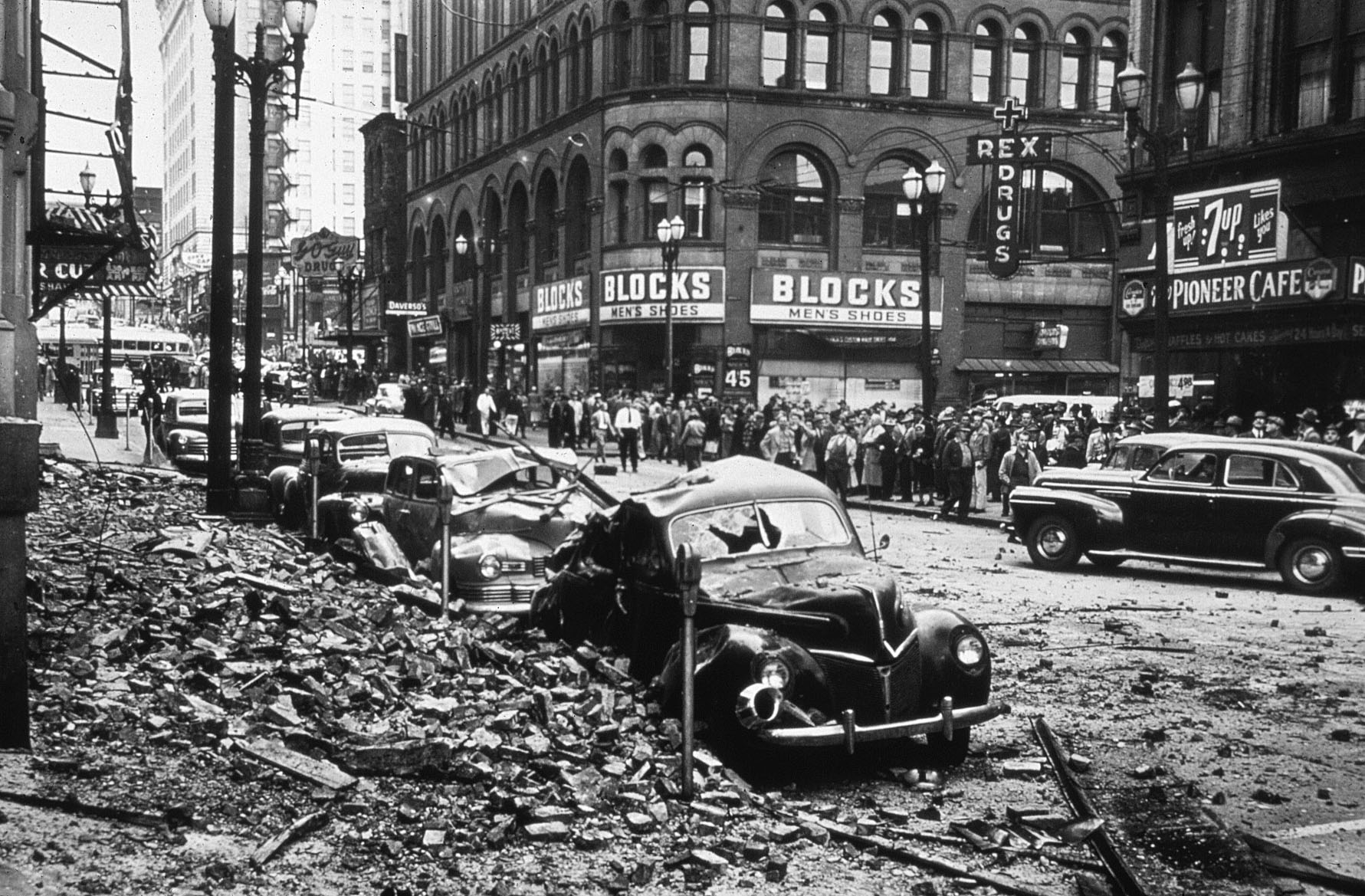 Yesler Way, downtown Seattle, showing damage in 1949 earthquake from falling parapets and brick ornamentation and a collapsed fire escape, shown at left.