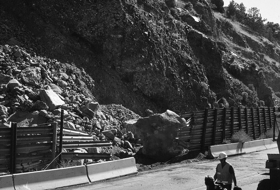 Boulder at Modoc Point, alongside U.S. Highway 97, that breached a roadside barrier and took the life of Ken Campbell during the September 20, 1993, Klamath Falls Earthquake. Boulder has been pushed back behind barrier.