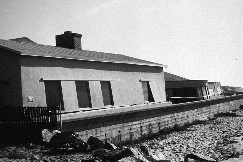 Tilted buildings at San Jose State University Marine Laboratory at Moss Landing, California, due to liquefaction of beach deposits during the October 1989 Loma Prieta Earthquake.