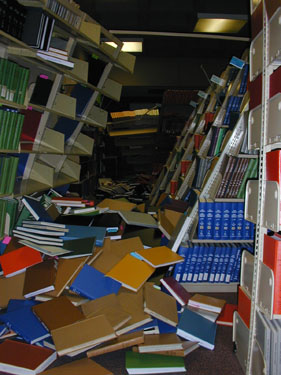 Bookcases collapsed during 2001 Nisqually Earthquake, showing the necessity of attaching heavy furniture to wall, especially furniture that might land on sleeping children.