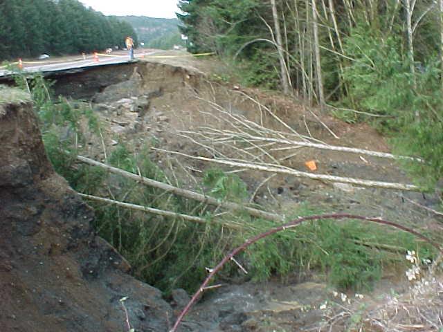 Landslide across Highway 101, about 100 feet across.