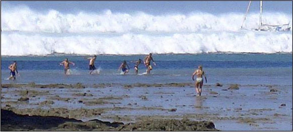 Swimmers at tourist resort of Phuket facing the December 26, 2004 tsunami accompanying an earthquake of M 9.15 off the northern tip of Sumatra. Although people now recognize their danger, it was too late, and all drowned in the tsunami. In the foreground, the sea bottom is exposed because the first wave was a drop in sea level.
