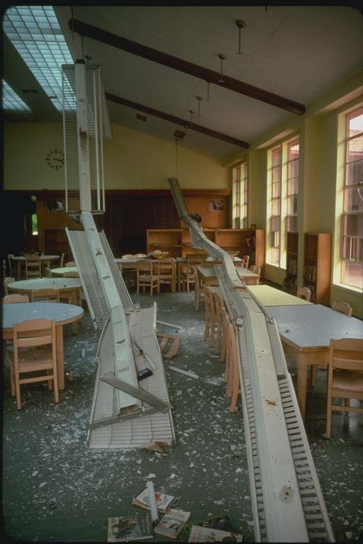 Failure of hanging light fixtures at library of Dawson Elementary School in California, fortunately unoccupied at time of earthquake