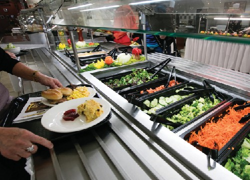 Food is an important vehicle of transmission for pathogens, especially of the gastrointestinal and upper respiratory systems. Notice the glass shield above the food trays, designed to prevent pathogens ejected in coughs and sneezes from entering the food.